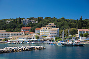 Spectacular beach resort and harbour of Kassiopi with blue sky and turquoise Ionian Sea, Corfu, Ionian Islands of Greece