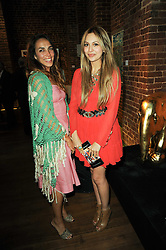 Left to right, AMEENA DASMAL and ZARA MARTIN at a private view of Sacha Jafri's paintings entitled 'London to India' held in aid of The Elephant Family charity at 23 Macklin Street, Covent Garden, London on 3rd June 2010.