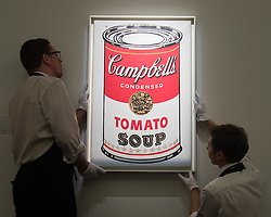 Sotheby's, London, January 28th 2016. Gallery technicians hang Andy Warhol's Large Campbell's Soup Can from 1964, which is expected to fetch up to £6.5 million, to be auctioned by Sotheby's in London as part of their sale of Impressionist, Modern, Surrealist and Contemporary art. ///FOR LICENCING CONTACT: paul@pauldaveycreative.co.uk TEL:+44 (0) 7966 016 296 or +44 (0) 20 8969 6875. ©2015 Paul R Davey. All rights reserved.