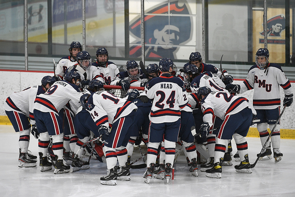 PITTSBURGH, PA - MARCH 12: The Robert Morris Colonials huddle up at the goal before Game One of the Atlantic Hockey Quarterfinal series against the Niagara Purple Eagles at Clearview Arena on March 12, 2021 in Pittsburgh, Pennsylvania. (Photo by Justin Berl/Robert Morris Athletics)