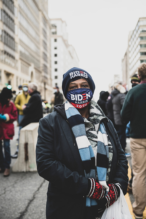"""Washington DC, USA - January 20, 2021: Patricia Fobbs, age 60, attends her first Presidential Inauguration. When I asked if I could take her picture, she replied -- softly, and with a cadence that was in no hurry, and a little grandmotherly -- """"Oh, I don't mind at all.""""<br /> I asked if she was from Washington DC. No, she was from New Orleans, and she had booked a ticket here as soon as it was clear that Biden and Harris had won the election. I asked why she wanted to come. <br /> """"It means so much to me that a black woman is becoming Vice President,"""" she said."""