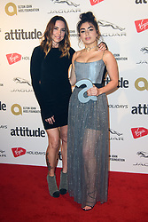 Charli XCX (right) with Melanie Chisholm, after winning the Music Award, at the Attitude Awards at the Roundhouse, London.
