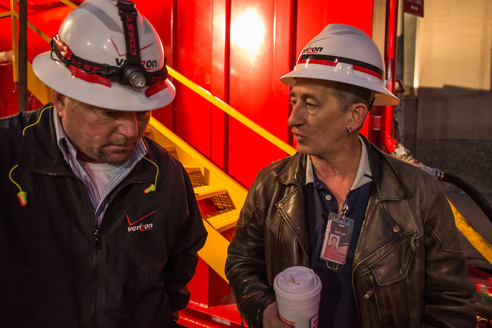 Verizon worker Frank Xavier, on the right, talks to a co-worker. Xavier and his crew are based in Rhode Island.