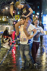 """© Licensed to London News Pictures . 15/12/2012 . Manchester , UK . Revellers enjoy a wet but busy night out on one of the last weekends before Christmas , a traditionally busy time when office parties and clubbers decent on bars and clubs , often known as """" Mad Friday """" . Photo credit : Joel Goodman/LNP"""
