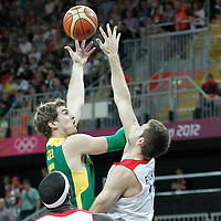 31 July 2012: Brazil Tiago Splitter goes for the skyhook over Great Britain Joel Freeland during 67-62 Team Brazil victory over Team Great Britain, during the men's basketball preliminary, at the Basketball Arena, in London, Great Britain.