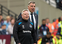 Football - 2017 / 2018 Premier League - West Ham United vs. Everton<br /> <br /> Sam Allardyce, Manager of Everton FC, and his assistant Sammy Lee look on as the Everton fans chant for them to go at the London Stadium<br /> <br /> COLORSPORT/DANIEL BEARHAM