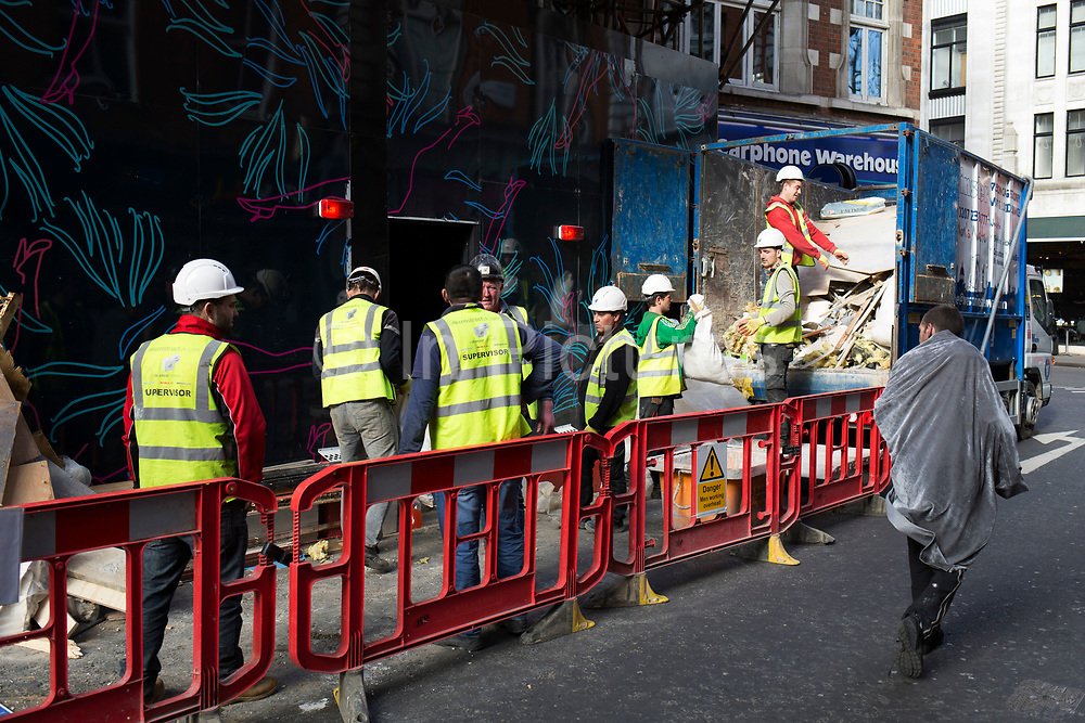 Street Scene showing the regeneration or gentrification of Soho, London, England, United Kingdom. Soho has always been known as the seedy part of town full of sex shops, peep shows and adult venues, like Madame Jojos, seen here being refurbished. While much of the local shop spaces are being closed and redeveloped into retail spaces, Madame Jojo is set to reopen as a club venue that has been updated.