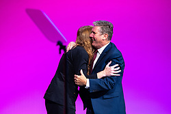 © Licensed to London News Pictures. 25/09/2021. Brighton, UK. ANGELA RAYNER hugs SIR KEIR STARMER after delivering the Deputy Leader's speech at the conference . The first day of the 2021 Labour Party Conference , which is taking place at the Brighton Centre . Photo credit: Joel Goodman/LNP