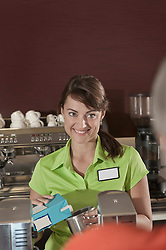 Young waitress smiling fitness studio counter