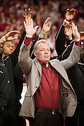 Jan 21, 2012; Fayetteville, AR, USA; Arkansas Razorbacks head coach Bobby Petrino calls the hogs during half time of a basketball game between the Michigan Wolverines and Arkansas Razorbacks at Bud Walton Arena. The football team was honor for winning the 2012 AT&T Cotton Bowl Classic. Arkansas defeated Michigan 66-64. Mandatory Credit: Beth Hall-US PRESSWIRE