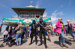 "© Licensed to London News Pictures. 27/05/2019. Clevedon, North Somerset, UK. Clevedon Troopers (dressed in black as Star Wars characters) support Clevedon Pier's 150th anniversary event. 2019 marks the 150th Anniversary of the opening of Clevedon Pier, an iconic Victorian structure and Grade 1 listed pier that attracts over 100,000 visitors per year. It was called ""The most beautiful pier in England"" by poet Sir John Betjeman. Photo credit: Simon Chapman/LNP."