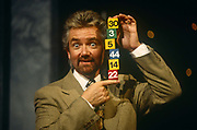 As first host of Britains lotter on television, British TV personality, Noel Edmonds shows lottery numbers in 1994, at the BBC Television Centre studios.