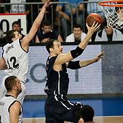 Anadolu Efes's Ermal KURTOGLU (R) during their Turkish Airlines Euroleague Basketball Group C Game 6 match Anadolu Efes between Partizan at Sinan Erdem Arena in Istanbul, Turkey, Wednesday, November 23, 2011. Photo by TURKPIX