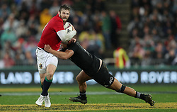 British and Irish Lions Elliot Daly is tackled by New Zealand's Anton Lienert-Brown during the second test of the 2017 British and Irish Lions tour at Westpac Stadium, Wellington.
