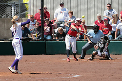 19 April 2014:  Stephanie Gallant bats in front of catcher Kacey Rogers during an NCAA women's softball game between the Evansville Purple Aces and the Illinois State Redbirds on Marian Kneer Field in Normal IL