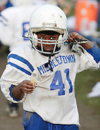 Middletown, NY - A Middletown player smiles and enjoys his post-game cookie after his team beat Wallkill in an Orange County Youth Football League Division 1 game to advance to the Super Bowl.