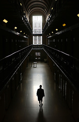 A female prison guard makes her rounds in the women's section of the Ghent prison, in Ghent, Belgium. (Photo © Jock Fistick)
