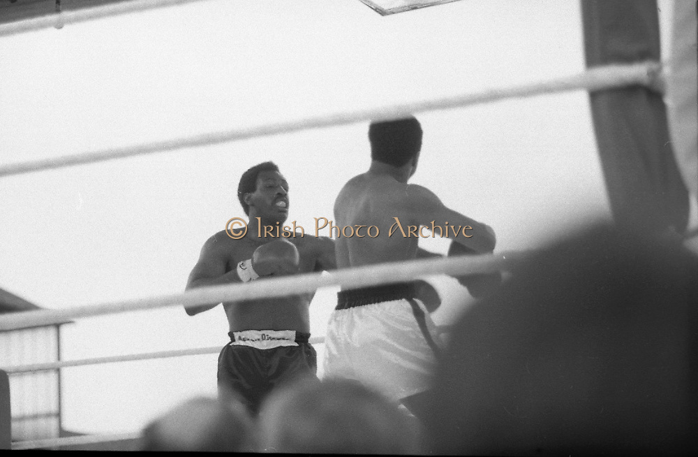 Ali vs Lewis Fight, Croke Park,Dublin.<br /> 1972.<br /> 19.07.1972.<br /> 07.19.1972.<br /> 19th July 1972.<br /> As part of his built up for a World Championship attempt against the current champion, 'Smokin' Joe Frazier,Muhammad Ali fought Al 'Blue' Lewis at Croke Park,Dublin,Ireland. Muhammad Ali won the fight with a TKO when the fight was stopped in the eleventh round.<br /> <br /> Photo shows Ali knocking Lewis back with a swinging left punch.