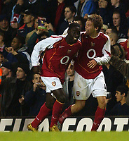 Fotball<br /> Carling Cup Fourth Round<br /> 09.11.2004<br /> Foto: SBI/Digitalsport<br /> NORWAY ONLY<br /> <br /> Arsenal v Everton<br /> <br /> Arsenal's goal scorers Quincy Owusu-Abeyie and Arturo Lupoli celebrate
