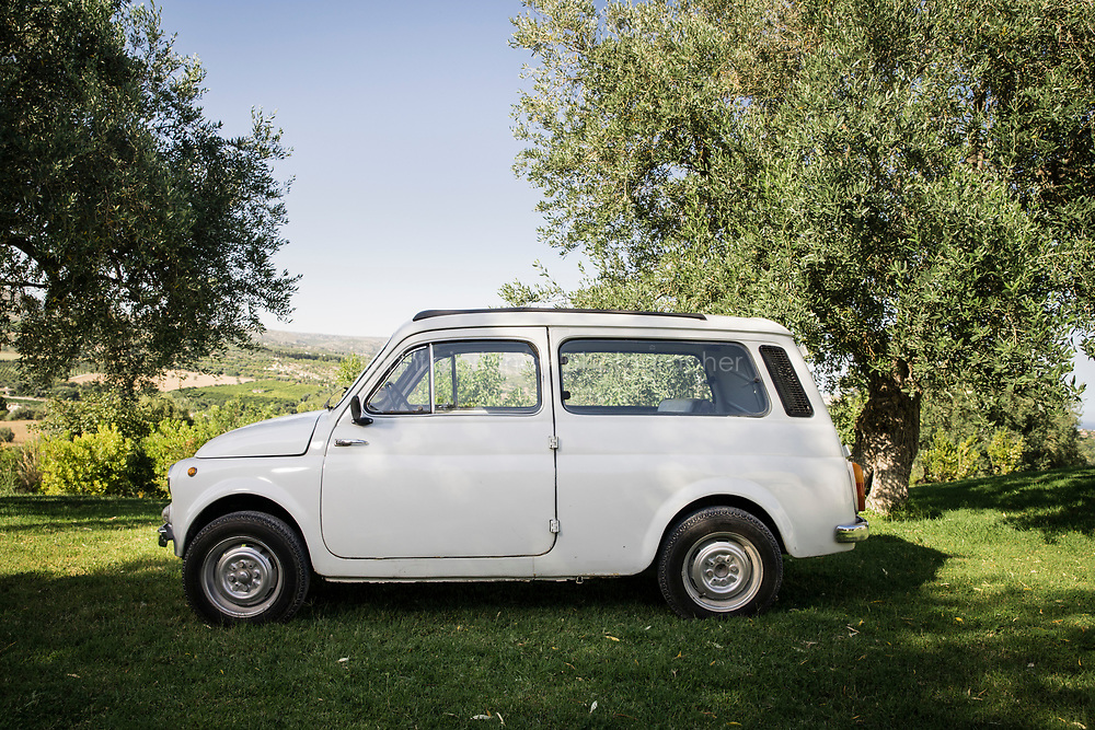 """NOTO, ITALY - 20 JUNE 2020: Jeweller Fabio Salini's vintage Fiat 500 Giardiniera car is seen here in by his Sicilian villa, where he retreats as oftens as he can, in the countryside of Noto, Sicily, Italy, on June 20th 2020.<br /> <br /> """"I consider jewellery to be an expression of art. It has to be based not just on an aesthetic achievement but also on concept,"""" says Salini, who cut his teeth fashioning spectacular baubles for the likes of <br /> Bulgari<br />  and <br /> Cartier<br /> , and continued to design for major houses after opening his swish atelier in Rome in 2004."""