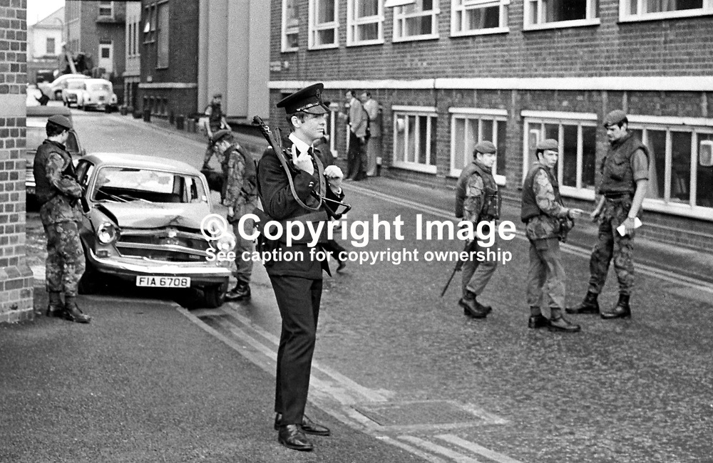 Soldiers and police examine the bullet-ridden crashed car in which a hospital porter coming off duty died at the Royal Victoria Hospital, Belfast, N Ireland, UK, 8th June 1977 in a Provisional IRA gun attack. Gerald Tucker, Belfast, N Ireland, 37 years old, Protestant, was a part-time lance corporal in the Ulster Defence Regiment. 197706080173a<br /> <br /> Copyright Image from Victor Patterson, Belfast, UK<br /> <br /> t: +44 28 9066 1296 (from Rep of Ireland 048 9066 1296)<br /> m: +44 7802 353836<br /> e: victorpattersonbelfast@gmail.com<br /> <br /> www.images4media.com<br /> <br /> Please see my full Terms and Conditions of Use at https://www.images4media.com/p/terms-conditions - it is IMPORTANT that you familiarise yourself with them.<br /> <br /> Images used online incur an additional cost. This cost should be agreed in writing in advance. Online images must be visibly watermarked i.e. © Victor Patterson or that of the named photographer within the body of the image. The original metadata must not be deleted from images used online.<br /> <br /> This image is only available for the use of the download recipient i.e. television station, newspaper, magazine, book publisher, etc, and must not be passed on to a third party. It is also downloaded on condition that each and every usage is notified within 7 days to victorpattersonbelfast@gmail.com.<br /> <br /> The right of Victor Patterson (or the named photographer) to be identified as the author is asserted in accordance with The Copyright Designs And Patents Act (1988). All moral rights are asserted.