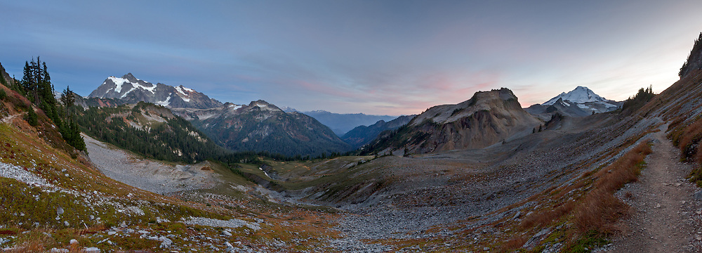 The Chain Lakes Trail skirts the south side of Table Mountain heading towards Ptarmigan Ridge, Mount Baker and the Chain Lakes. This spot has great views of Mount Shuksan, Happy Bunny Butte, Mount Baker and numerous other North Cascades peaks and ranges. Photographed in the Mount Baker Wilderness in the North Cascades of Washington State, USA.