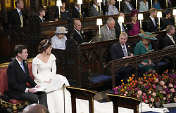 File photo dated 24/06/18 of Princess Eugenie and her husband Jack Brooksbank, as she looks back towards the Duke of York and Sarah, Duchess of York (seated front), Queen Elizabeth II, the Duke of Edinburgh, Prince of Wales, the Duke and Duchess of Cambridge, and the Duke and Duchess of Sussex, during their wedding at St George's Chapel in Windsor Castle. The Duke of Edinburgh has died, Buckingham Palace has announced. Issue date: Friday April 9, 2020.