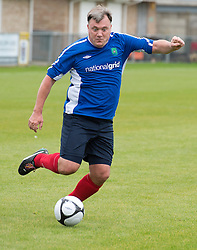 © London News Pictures. 22/09/2013 . Lancing, UK.   British Shadow Chancellor ED BALLS taking part in a football match between Labour Members of Parliament and journalists in Lancing, West Sussex, on day one of the Labour Party Annual COnference which is being held in Brighton. Photo credit : Ben Cawthra/LNP