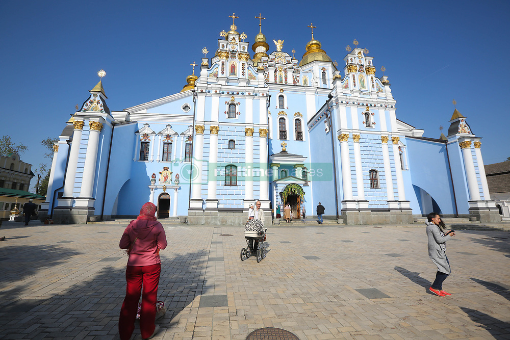 April 27, 2019 - Kiev, Ukraine - People walk near the St. Michael's Golden-Domed Cathedral at St. Michael's Golden-Domed Monastery in Kyiv, Ukraine, April 27, 2019. Easter is celebrated around the world by Easter Christians to mark the resurrection of Jesus Christ from the dead and the foundation of the Christian faith. (Credit Image: © Sergii Kharchenko/NurPhoto via ZUMA Press)