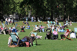 ©  licensed to London News Pictures. . UK.27/04/2011.Royal Wedding Preparations today in London with only two days to go before the big day..People relaxing in St James Park as the worlds media goes mad 100 yards away..Please see special instructions..Picture credit should read Grant Falvey/LNP......