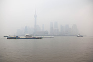 China, Shanghai.Pudong slyline view from the Bund promenade on a foggy day
