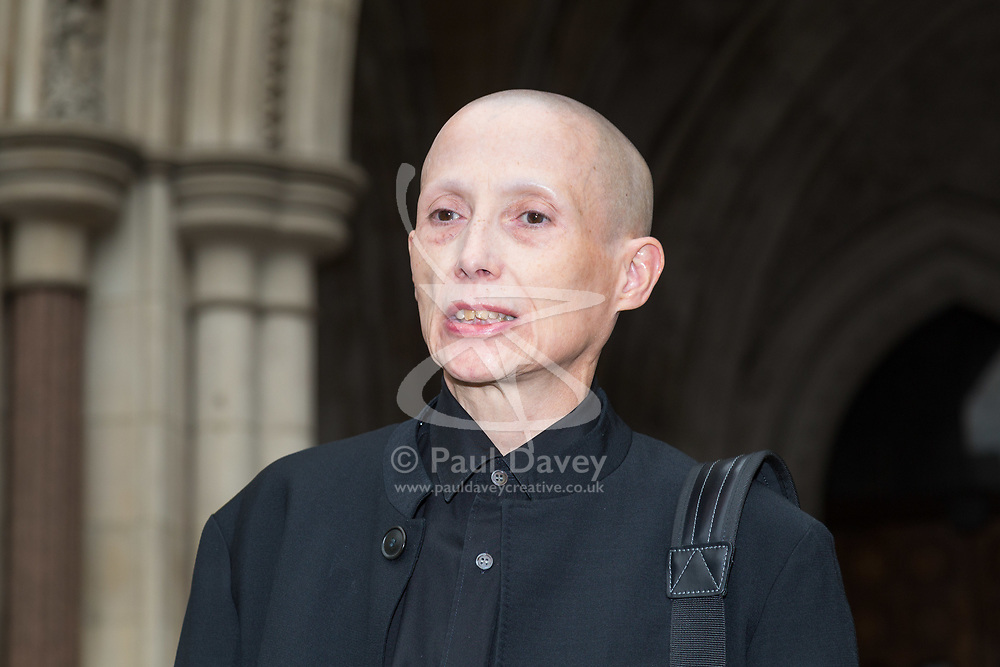 """London, October 11 2017. Non-gendered campaigner Christie Elan-Cane arrives at the High Court where she is launching a fight for the right to have """"X"""" passports in the UK. Applicants currently have no choice other than to indicate whether they are male or female. © Paul Davey"""