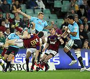 Lachie Turner and Ben Smith jumps for the ball. NSW Waratahs v Otago Highlanders. Investec Super Rugby Round 17 Match, 11 June 2011. Sydney Football Stadium, Australia. Photo: Clay Cross / photosport.co.nz