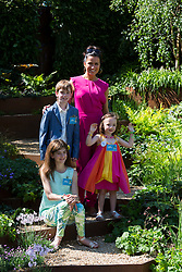 © Licensed to London News Pictures. 19/05/2014. London, England. Pictured: Presenter Susanna Reid with children born prematurely, in the First Touch garden. Press Day at the RHS Chelsea Flower Show. On Tuesday, 20 May 2014 the flower show will open its doors to the public.  Photo credit: Bettina Strenske/LNP
