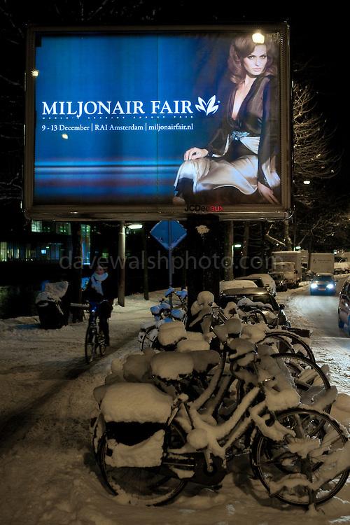 Millionaire Fair: illuminated poster on a street in Amsterdam, December, 2010