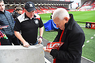 Bristol City owner Steve Lansdown signs his autograph for a fan before the The FA Cup 5th round match between Bristol City and Wolverhampton Wanderers at Ashton Gate, Bristol, England on 17 February 2019.