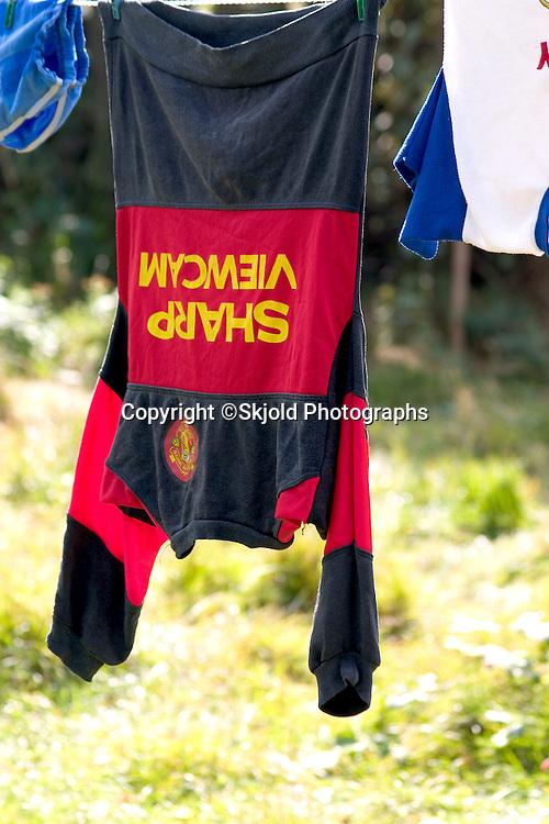 Colorful shirt drying on line in Polish farmyard.  Zawady   Central Poland