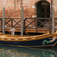 Beautiful boat docked along a canal in Venice, Italy