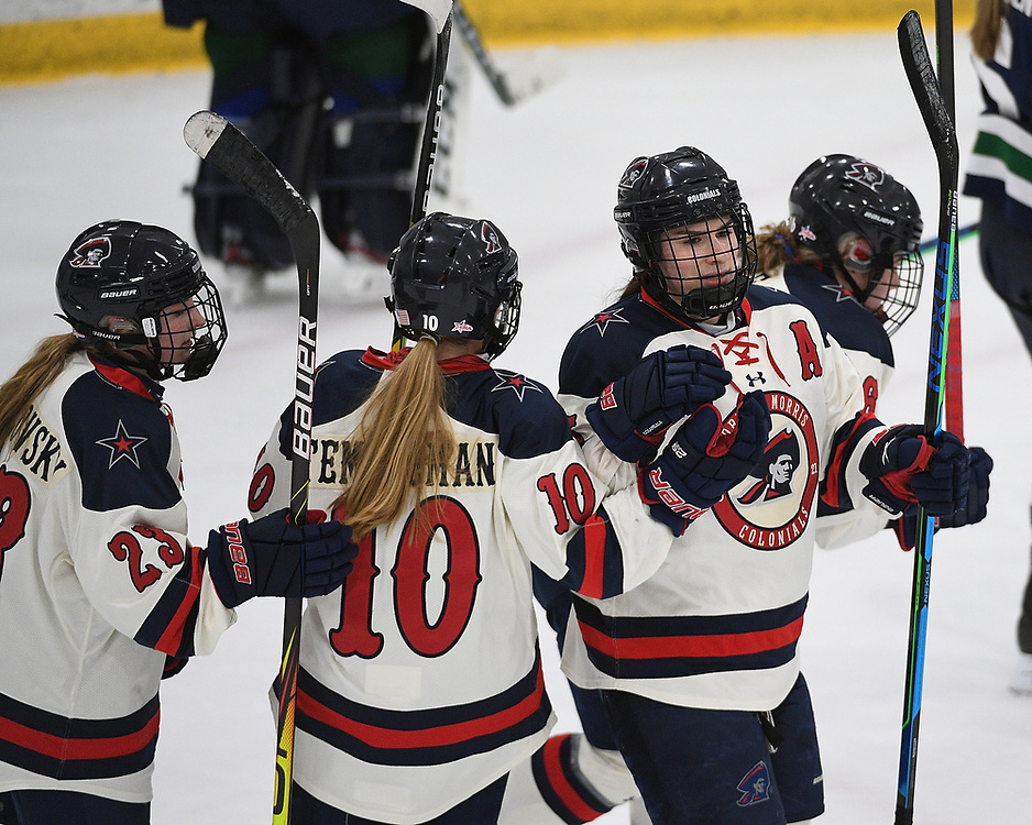 PITTSBURGH, PA - FEBRUARY 09: Emily Curlett #5 of the Robert Morris Colonials celebrates with teammates after scoring a goal in the first period during the game against the Mercyhurst Lakers at Clearview Arena on February 09, 2021 in Pittsburgh, Pennsylvania. (Photo by Justin Berl/Robert Morris Athletics)
