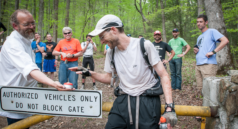"""Race Director Lazarus Lake (Gary Cantrell) offers Brett Maune the """"That Was Easy"""" button after winning the 2012 Barkley Marathons. Maune set a new course record of 52:03:08."""
