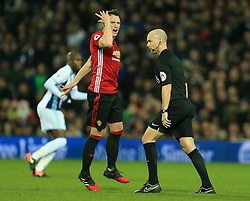 17 December 2016 - Premier League - West Bromwich Albion v Manchester United - Phil Jones of Manchester United appeals a decision to the referee - Photo: Paul Roberts / Offside.