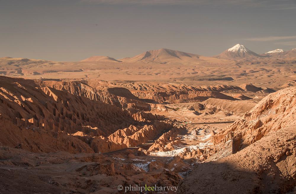Road on desert, mountains on background, Valle de la Luna, Atacama Desert, Chile