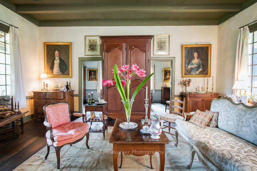 The main living area or salon principal in Maison Chenal contains a Creole style mix of modest and elegant furnishings. For over 50-years Dr. Jack and Pat Holden have researched and collected historical artifacts of 18th and 19th century Louisiana. The extensive collection resides on 110 acres in Pointe Coupee Parish with two main houses:  Maison Chenal, a circa 1790 West Indies style Louisiana Creole house and the Nicholas LaCour House, built in the mid-1700's.