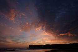 © Licensed to London News Pictures. <br /> 08/10/2014. <br /> <br /> Saltburn, United Kingdom<br /> <br /> Dawn breaks as the sky is dramatically lit up over Huntcliff and Saltburn beach in Cleveland.<br /> <br /> Photo credit : Ian Forsyth/LNP