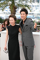 Kim Kang-woo, Youn Yuh-jung, at The Taste of Money photocall at the 65th Cannes Film Festival France. Saturday 26th May 2012 in Cannes Film Festival, France.
