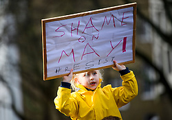 © Licensed to London News Pictures. 04/02/2017. London, UK. 5 year old Lara holds up a banner while taking part in a demonstration against U.S President Donald Trump's Executive Order banning refugees and immigrants from a number of Muslim-majority countries. Protestors join campaign groups including Stop the War, Stand up to Racism, Muslim Association of Britain, in a march from the U.S Embassy in London to Downing Street. Photo credit: Ben Cawthra/LNP