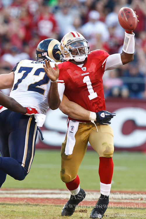 November 14, 2010; San Francisco, CA, USA;  San Francisco 49ers quarterback Troy Smith (1) breaks a tackle from St. Louis Rams defensive end Chris Long (72) during the fourth quarter at Candlestick Park. San Francisco defeated St. Louis 23-20 in overtime.