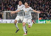 Football - 2017 / 2018 Premier League - Crystal Palace vs. Manchester United<br /> <br /> Nemanja Matic (Manchester United) followed by Chris Smalling (Manchester United) after he scores the winning goal <br /> at Selhurst Park.<br /> <br /> COLORSPORT/DANIEL BEARHAM