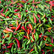 Detail of red and green chillies for sale at Khlong Toei market, Bangkok