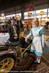 """Mr Martini's booth with the Mad Hatter, Alice, the White Rabbit and King of hearts in their Alice in Wonderland """"Through the Looking Glass"""" theme during the Motor Bike Expo. Verona, Italy. January 22, 2016.  Photography ©2016 Michael Lichter."""